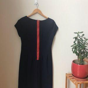 Blue dress with orange zipper